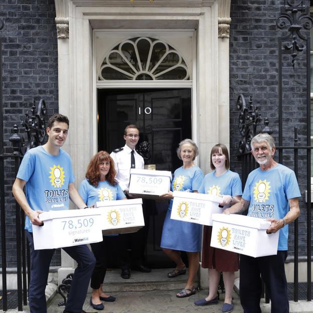 Handing in the Toilets Save Lives petition at Downing Street